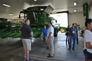 Attendees check out the massive farm equipment at Plattner Farms.