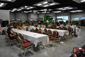 Attendees enjoyed lunch at the Ag-Power dealership surrounded by John Deere tractors.